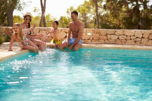 Wide Angle View Of Family On Vacation Having Fun By