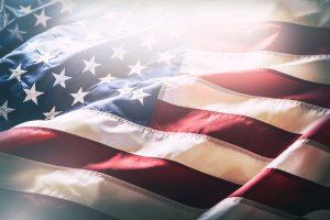 USA flag. American flag. American flag blowing wind. Close-up. Studio shot