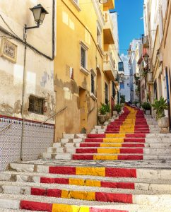 Public steps painted with Spanish flag colors in Southern Spain village