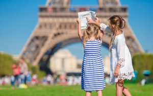 Adorable little girls with map of Paris