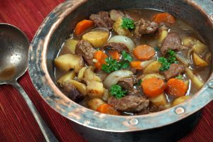 Irish stew in copper bowl, with vintage spoon