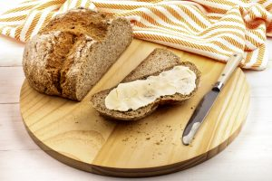 irish soda bread with creamy irish butter on a wooden plate
